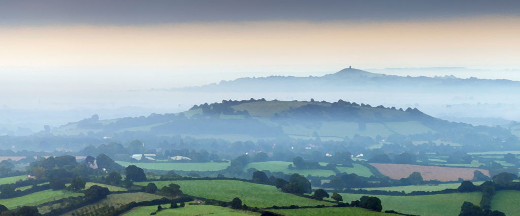 glastonbury tor in the foggy distance