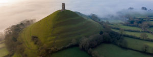 banner for locations of arthurian legend, featuring glastonbury tor
